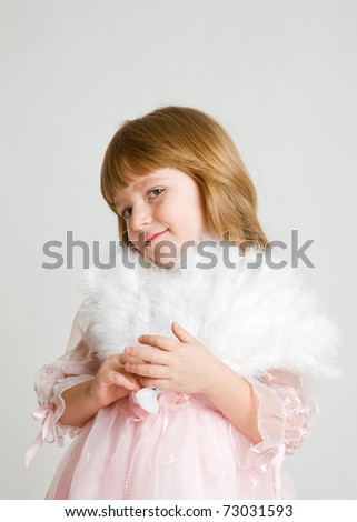 four-year girl in a beautiful pink dress with a fan. It is isolated on a white background
