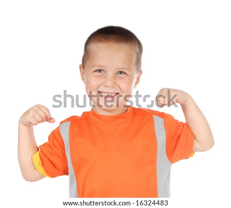 Four year old boy flexing his little muscles - stock photo