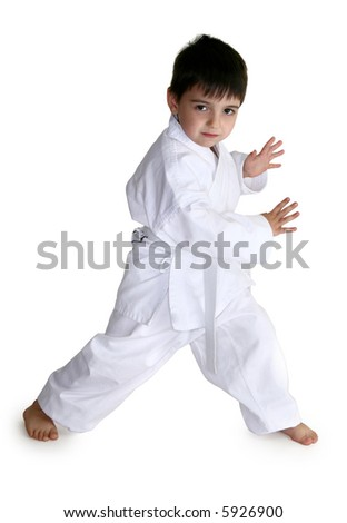Four year old boy showing off his karate moves.  Clipping path included. - stock photo