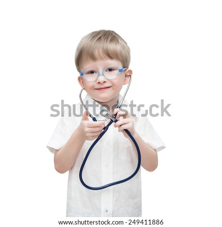 Four-year-old boy wearing spectacles with a stethoscope, isolated on the white - stock photo