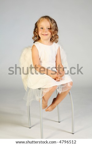 Four years old girl as an little angel. - stock photo