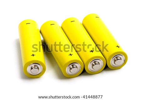 four yellow alkaline batteries isolated on white background