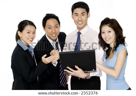 Four young asian businessmen and women with a laptop computer - stock photo