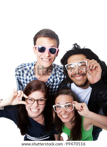Four young diverse people looking up with nerdy glasses. - stock photo