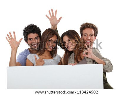 four young positive people - stock photo