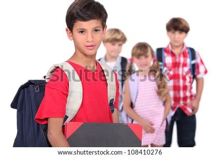 Four young schoolchildren - stock photo