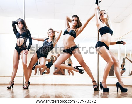 Four young sexy pole dance women. Bright white colors. - stock photo