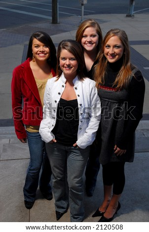 Four young students posing on street - stock photo