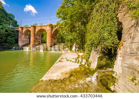 fourteenth century bridge in masonry over the River in a small village in the hills in Romagna, Italy