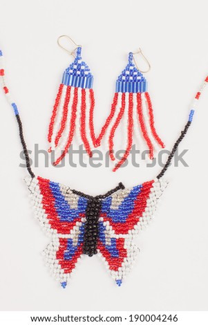 Fourth of July beaded jewelry of red, white and blue flag earrings and a butterfly necklace