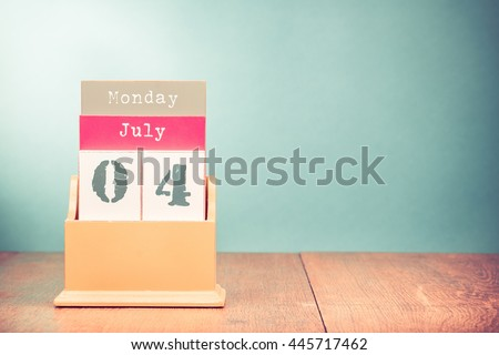 Fourth of July on retro wooden desk calendar. Date of USA Independence Day holiday. Vintage style filtered photo