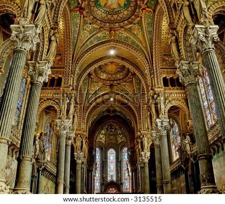 Fourviere basilica nave contains some beautiful stained glass, as well as some 19th century Byzantine art. - stock photo