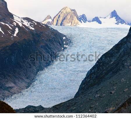 Fox Glacier in New Zealand - stock photo