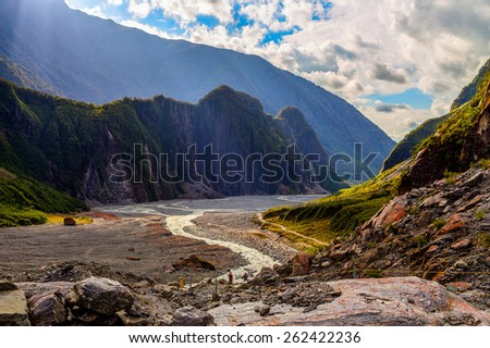Fox glacier valley and stream in South Alps, South island of New Zealand - stock photo