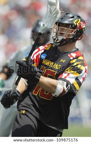 FOXBOROUGH - 28 MAY: Landon Carr (16) from the University of Maryland, College Park, passes the ball at the NCAA Men's Division 1 Lacrosse Championship game in Foxborough, Massachusetts, 28 May 2012.