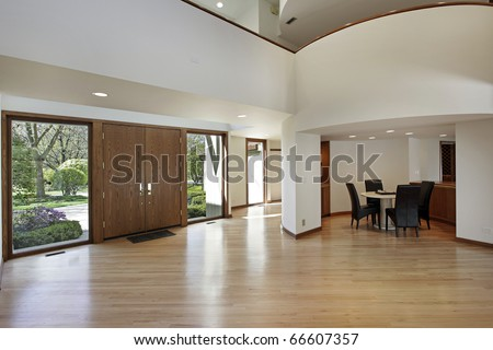 Foyer in luxury home with rounded second floor landing - stock photo
