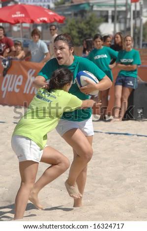 Foz do Arelho - August 09: Beach games -  4th Beach Rugby 2008 (POR) Women Game, August 09, 2008 in Foz do Arelho, Portugal - stock photo