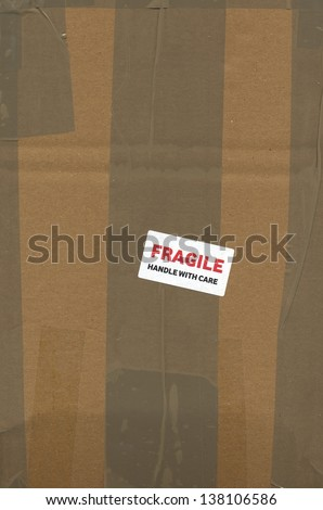 Fragile handle with care - corrugated cardboard packet - stock photo