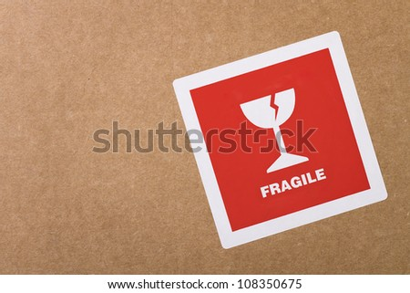 Fragile sticker at the cardboard box with copy space