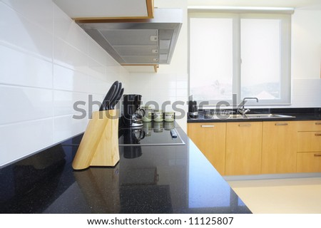 Fragment like view of nice light fully furnished kitchen - stock photo