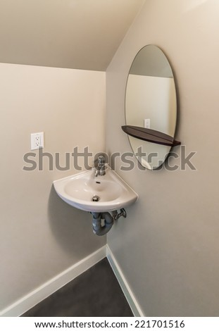 Fragment of a bathroom, washroom with wash basin, sink and the mirror. Interior design. - stock photo
