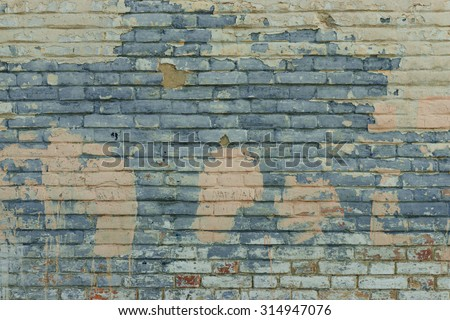 Fragment of a brick wall with cracks, scratches and attritions