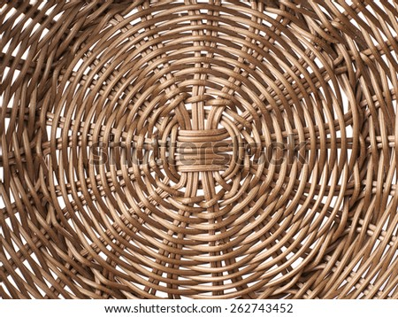 Fragment of a brown wicker basket as a background texture composition - stock photo