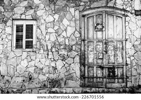 Fragment of a building in Tel Aviv, Israel with a door and a window - stock photo