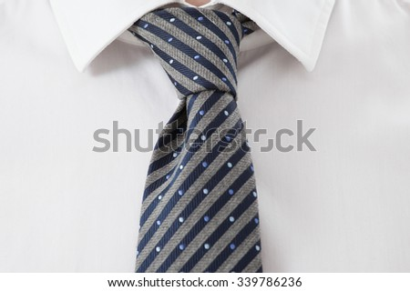 Fragment of a businessman's shirt and necktie , white background - stock photo