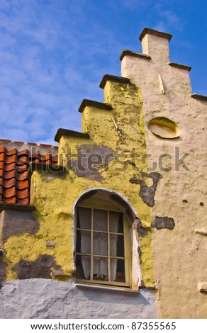 Fragment of a classical dwelling house in Bruges. Belgium. Summer urban landscape. Dutch culture. - stock photo