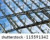 Fragment of a microwave antenna of the radar on the background of blue sky - stock photo