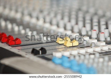 Fragment of a mixing console closeup - stock photo