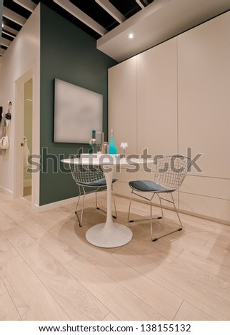 Fragment of a modern living, dining room with a table and two chairs. Interior design. - stock photo