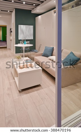 Fragment of a modern living room with the couch, sofa and the dining table with two chairs. Interior design. - stock photo