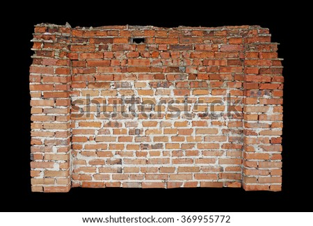 Fragment of a ruined brick wall - stock photo