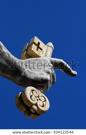 Fragment of a sculpture of apostle Peter - a hand with two keys - established on a St Peter's place in Vatican - stock photo