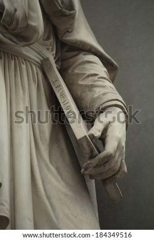 fragment of a statue of Leonardo da Vinci. Statue outside the Uffizi. Florence, Italy  - stock photo