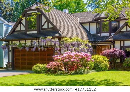 Fragment of a very neat and colorful home with gorgeous outdoor landscape in suburbs of Vancouver, Canada - stock photo