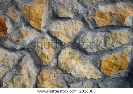 Fragment of a wall reveted by a stone - stock photo