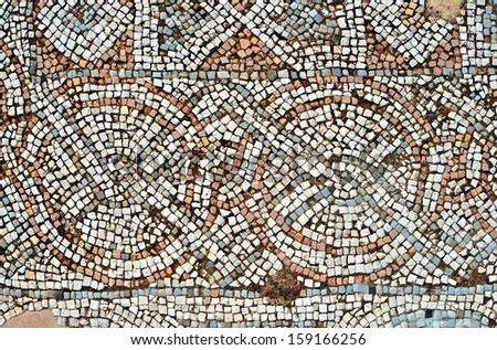 Fragment of an ancient  floor mosaic. Colorful tiles and stones of different sizes, unusual geometric ornament, regular forms. Euthymius Monastery. Israel  St. Euthymius Monastery. Israel - stock photo