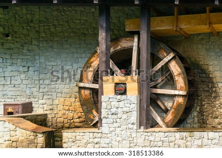 fragment of an old mill water-powered - stock photo