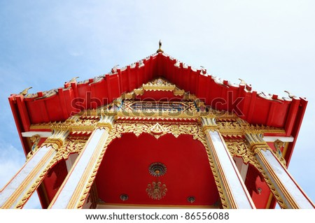 Fragment of ancient carved roof of Buddhist temple Wat Chalong in Phuket, Thailand - stock photo