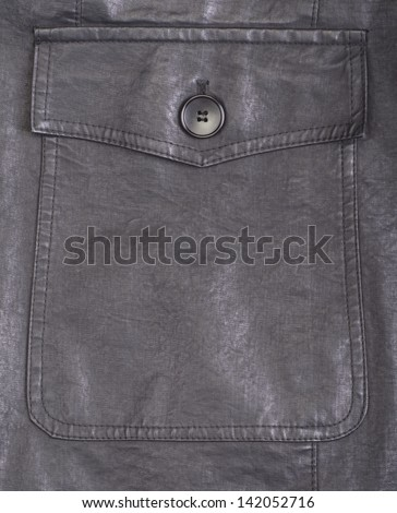 Fragment of black leather jacket with button - stock photo