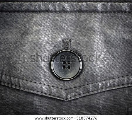 Fragment of black leather jacket with button clous-up - stock photo