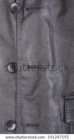 Fragment of black leather jacket with some buttons - stock photo