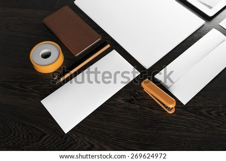 Fragment of blank stationery and corporate identity template on wooden background.  For design presentations and portfolios. - stock photo