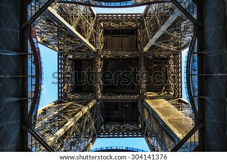 Fragment of construction Eiffel Tower (La Tour Eiffel). Paris, France. Eiffel Tower named after engineer Gustave Eiffel, is tallest structure in Paris and most visited monument in world.  - stock photo