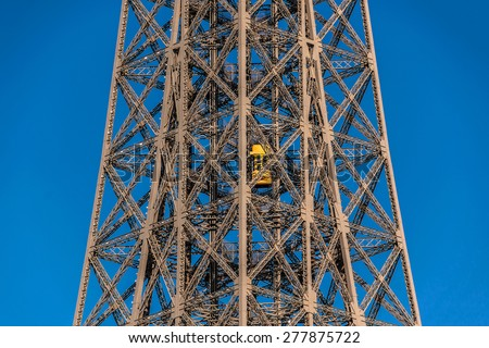 Fragment of construction the Eiffel Tower (La Tour Eiffel). Paris, France. Eiffel Tower, named after engineer Gustave Eiffel, is tallest structure in Paris and most visited monument in world. - stock photo
