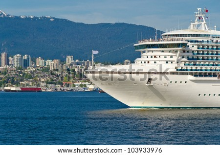 Fragment of cruise ship over snow mountain in the harbour in Vancouver, Canada. - stock photo