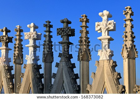 Fragment of Duomo steeples on Cathedral roof top in Milan. - stock photo